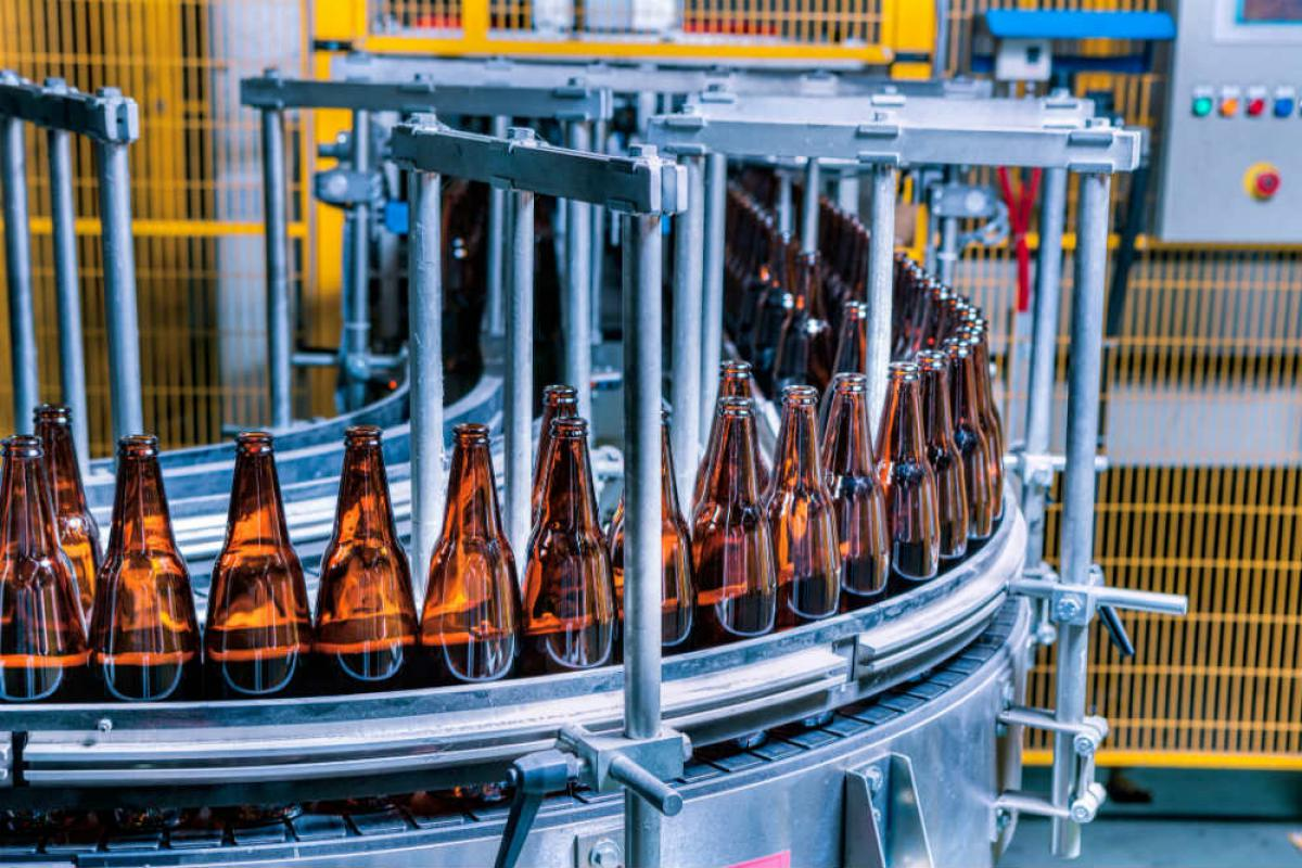 Beer being bottled at production plant